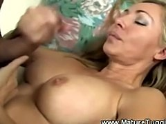 Hot mama plays with younger cock