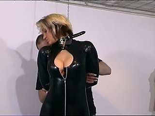 Kinky slut in latex have a nice boot cuddle by her slave...