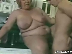 BBW mature fucks younger dude in kitchen