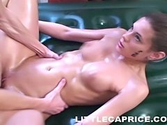 Oily and naked Caprice giving full body massage and fucking hard