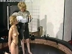 Vintage video of slave geting her tits coverd in hot candlewax while another...