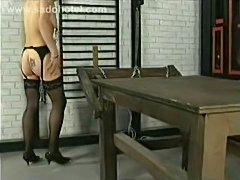 Slave with tiny tits walking around with large metal clamps on her nipples...