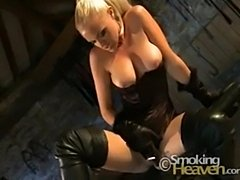 Hot blonde smoking in corset and leather boots