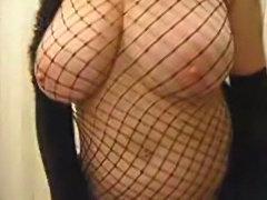 Fishnet Milf stripteasing with bigboobs