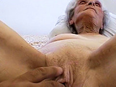 Nasty granny slut sucking cock