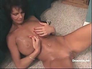 In this video Deauxma is shown coming home from work in her business suit and she slowly strips out of it in front of her bedroom mirror. Deauxma plays with herself in the mirror for a bit and then goes to take a shower.