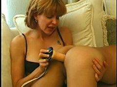 She spanks him lightly and dildo fucks him