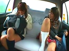 2 Japanese school girls have a long fucking session with a cabbie in the...