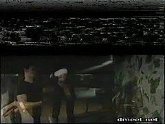 A scene from Vanessa Del Rio In Bondage, whipping in bondage with a collar...