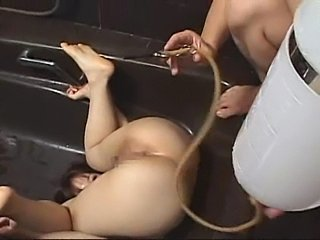 girl gets milk enema upside down in the tube
