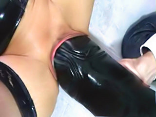 Latex Whore forcing monster dildo in her cunt
