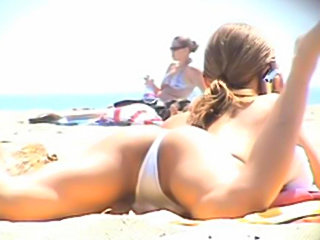 Amateur babe with white bikini on beach
