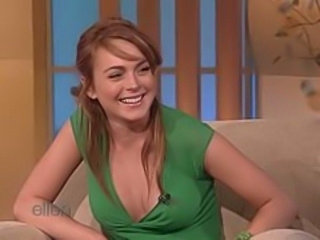 Lindsay wears a hot top showing her cleavage