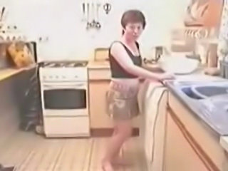 wendy strips in the kitchen while making dinner