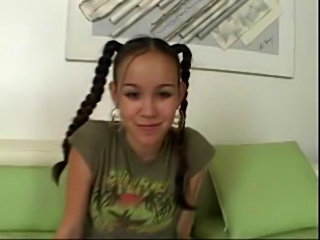 Innocent and young looking with pigtails