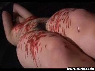 Hot wax dripped on Asian in bondage