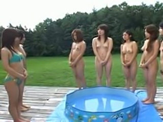 Japanese AV Model and cute lesbians get wet in public
