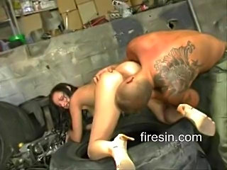 Michelle Wild fucks a mechanic in the garage while she screams for more, then let's him slop his glop on her sexy face.