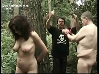 Naked slave tied to a tree got her pierced pussy played by m free