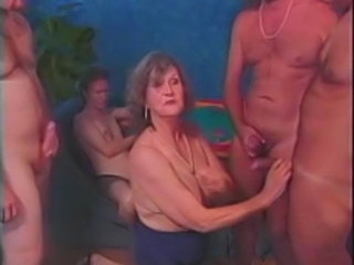 Granny sucking bunch of young guys and get fucked.