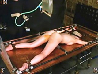 Slave gets Enema punishment on anal table