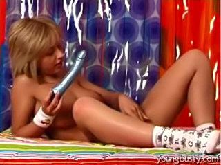 Busty teen stripping and masturbating