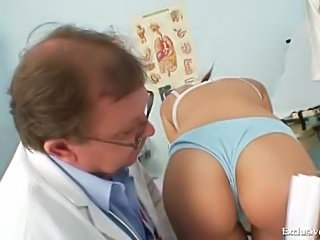 Girl in stockings and schoolgirl skirt examined