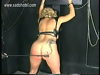 Older slave with a large tattoo on her back is spanked and g free