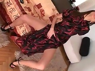Eufrat plays with machine in a chinese dress