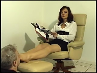 He smells the feet of the femdom