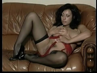Sultry striptease from big tits milf