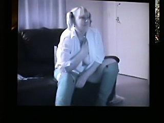Fatty in pigtails strips and plays with tits and pussy