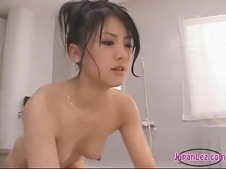 Blindfolded girl standing with tied arms nipples and pussy s free