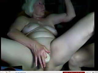 Granny on webcam toys her tight pussy