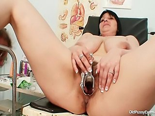 Big boobs chubby milf Zora gets her hairy bush inspected with gyno speculum tool