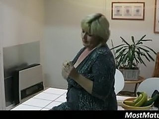 Big blonde mature gets all horny and touches her tits...