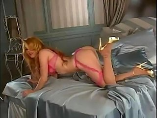 Very sexy chick strips out of lingere and masturbates