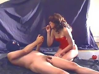 Cherilynn milks her slave while enjoying a cigar