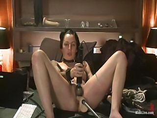 Brunette girl is trying out a fuck machine and loves using it