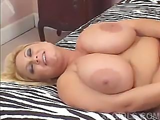 Busty blonde enjoys sucking and riding a hard dick