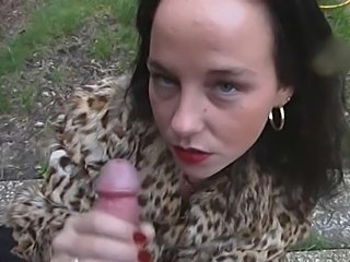 Nasty brunette gave a fast handjob outdoors and got her face covered with cum
