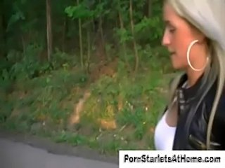Blonde in leather gives outdoor handjob  free