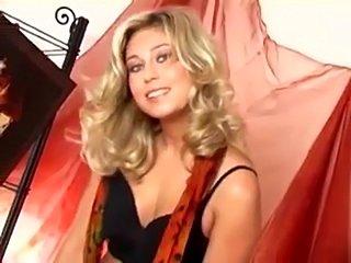 Beautiful blonde in stockings masturbates