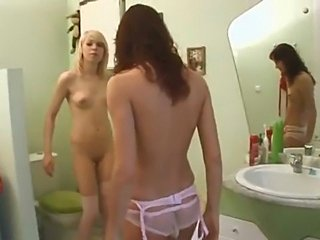 Turned out lesbians in crotchless panties make it in a bathroom