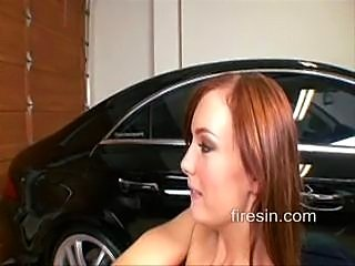 A cute redhead with small perky tits fucks a mechanic in the garage