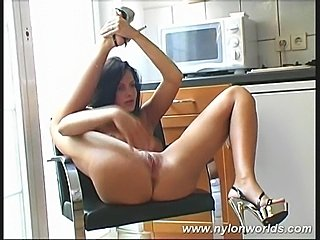 Chick posing in kitchen