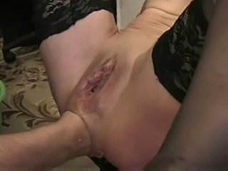 Fist disappears into her asshole