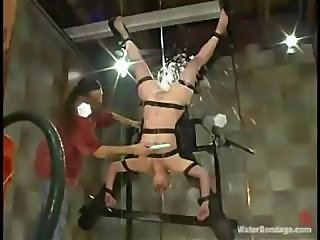 Blonde babe is strung up and caged as her mistress punishes her