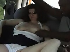 Slutwife sucks a long black cock in the back seat of their car while hubby films
