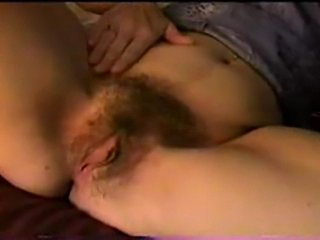 An open minded American milf, 39 years, with a ruddy hairy pussy.  Fingering,...